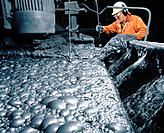 Millman takes sample from flotation cells in mill at zinc-lead mine. Faro. Yukon. Canada