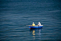 Two men fishing in the Mediterranean sea