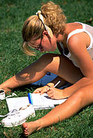 Teenage girl studying on campus