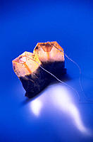 Two tea bags in bright blue light