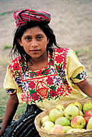 Young girl selling apples. Santa Catarina Palopo. Guatemala