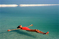 Woman floating on the Dead Sea. Israel