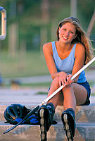 Girl with in-line hockey equipment