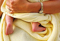 Mother holding baby in blanket
