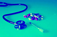 Pills, syringe and stethoscope