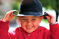 Young girl with cowboy hat