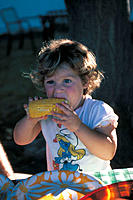 Little girl eating corn on the cob
