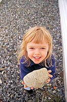 Little girl holding a rock