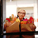 Elderly man with groceries
