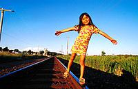 Girl, 6 years old, balancing on railroad track