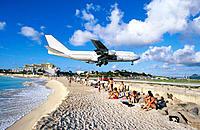 Airliner landing at airport at Maho Bay. Sint Maarten