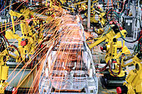 Robotic arms welding car frames on Saturn assembly line. Tennessee. USA