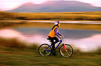 Woman riding mountain bike. Alaska. USA