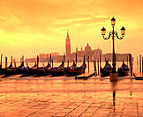 Gondolas and San Giorgio Maggiore island in background. Venice. Italy