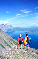 Women hiking on King´s Throne mountain, overlooking Kathleen Lake. Kluane National Park. Canada