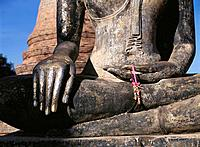 Detail of Buddah statue at Buddhist sanctuary, 13th century. Sukhothai. Thailand