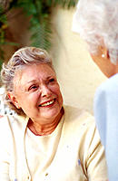Two mature women in conversation