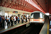 Mass rapid transit train arriving at interchange station. Singapore