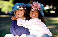 Two young girls wearing hats portrait