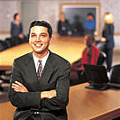 Portrait, Smiling Young Businessman in Boardroom