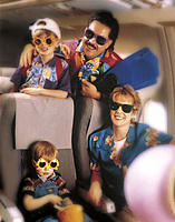 Family in Hawaiian Shirts on Airplane