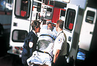 EMT Workers Loading Patient into the Ambulance