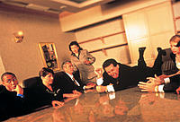 Executive throwing a tantrum on meeting table
