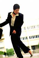 Executive woman with her heel stuck in gum