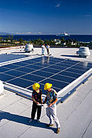 Hawaii, BigIsle, Kona Gym, Solar panel installation, men w/ hard hat B1151