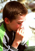 Solvent abuse. 11-year-old boy inhaling solvent fumes from a plastic bag. Also known as glue sniffing, solvent abuse is highly dangerous and can have ...
