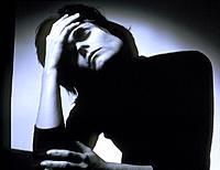 Headache. Woman suffering from a headache holding her forehead.