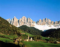 Church with Dolomites in background. Tuscany. Italy