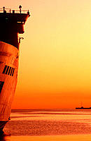 Passenger ship in dock at sunset