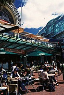 Tourist sitting in a sidewalk cafe, Darling Harbor, Sydney, New South Wales, Australia