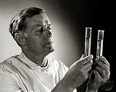 Close-up of a scientist comparing chemicals in two test tubes