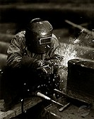 High angle view of a welder welding in a factory