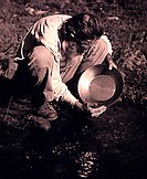 High angle view of a miner panning for gold