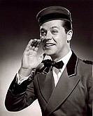 Close-up of a bellhop talking with his hand near his mouth