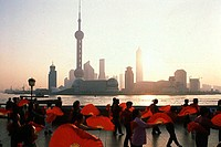 Group of people holding folding fans, The Bund, Shanghai, China