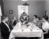 Family at a dining table on Thanksgiving Day