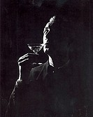 Close-up of a mature man drinking a martini