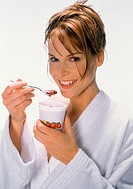 Young woman eating strawberry yoghurt (3)