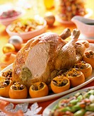 Stuffed turkey on a platter with stuffed oranges