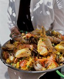 Person holding mixed paella (1)