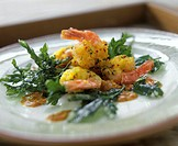 Fried shrimps and fried parsley with harissa