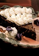 A Slice of Flourless Chocolate Cake with Frosting