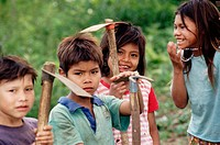 Guarani children learning to work the land. Misiones province. Argentina