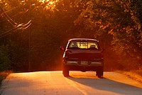 Pickup truck heading into sunset