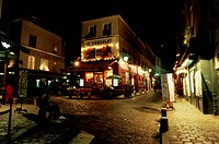 Stores in a market lit up at night, Montmartre, Paris, France