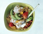 Muesli with fruit and yoghurt in green bowl (1)